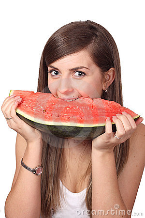 Girl eating slice of water-melon