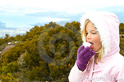 Girl eating snow