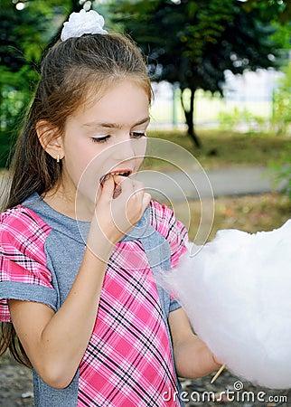 Girl eating sweet cotton wool