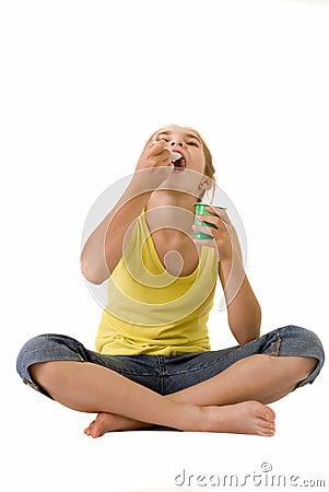 Girl eating yoghurt III