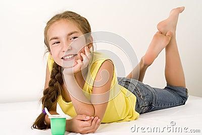 Girl eating yoghurt VII
