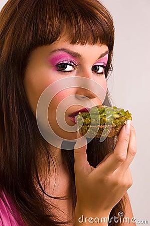 The  girl eats a cake