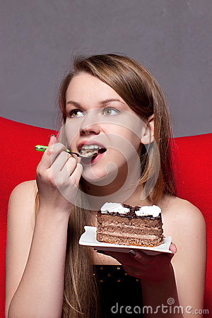 Girl eats chocolate cake