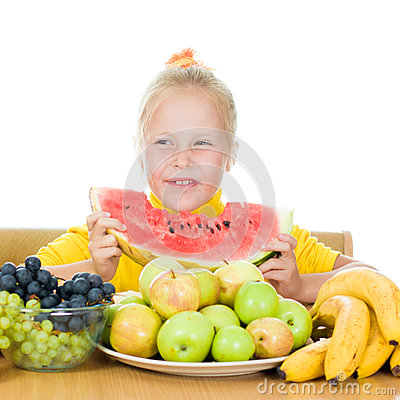 Girl eats fruit