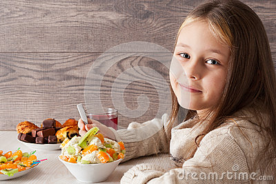 girl eats fruit dessert in cafe