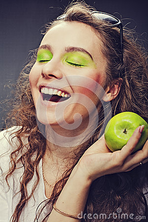 Girl eats a juicy apple