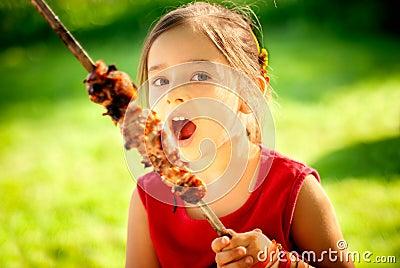 Girl eats kebab