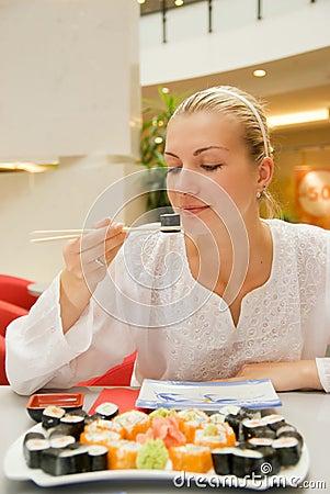 Girl eats sushi