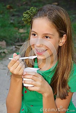 Girl eats yogurt