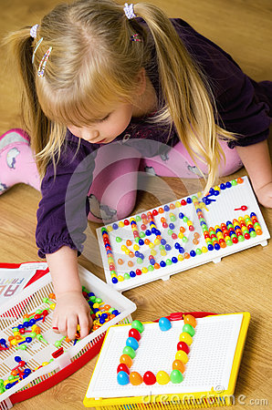Girl with educational pin puzzle toy