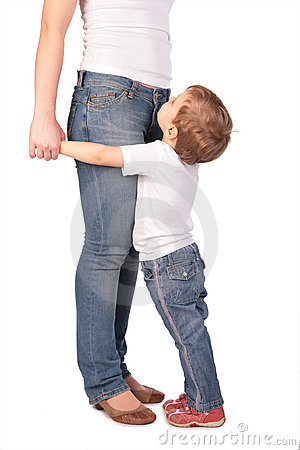 Girl embrace mother legs