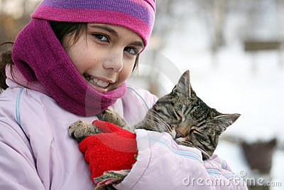Girl embraces cat