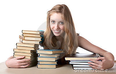The girl embraces a pile of books