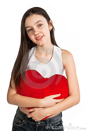 Girl embraces a pillow in the form of heart