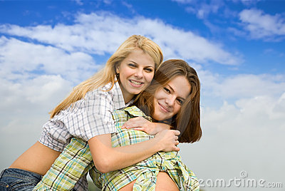 Girl embracing  girlfriend