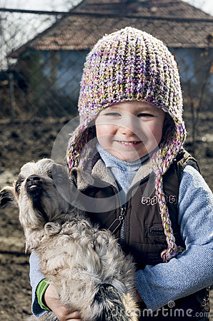 Girl embracing a goatling.