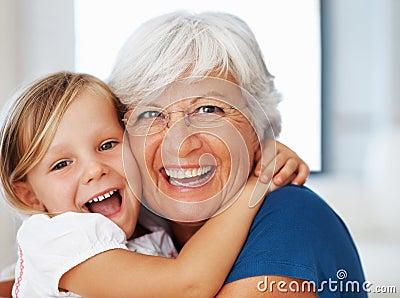 Girl embracing grandmother