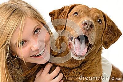 Girl embracing her dog