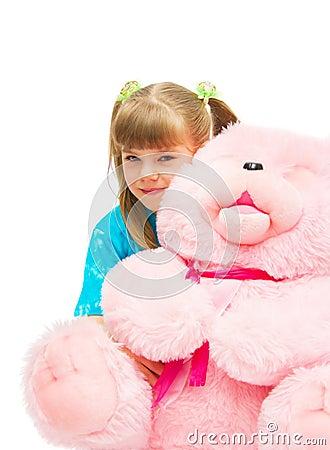 Girl embracing a pink bear