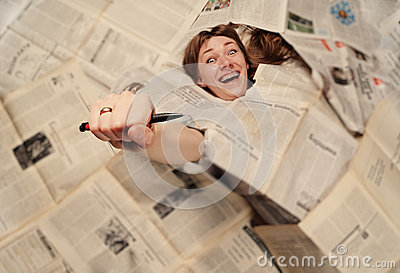 Girl engulfed with newspapers
