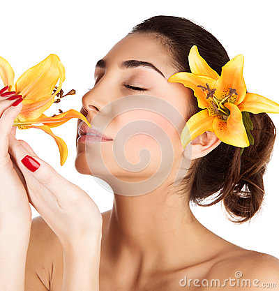 Girl enjoy lily flower smell