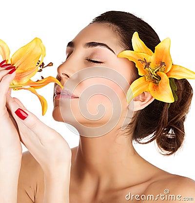 Girl enjoy lily flower smell