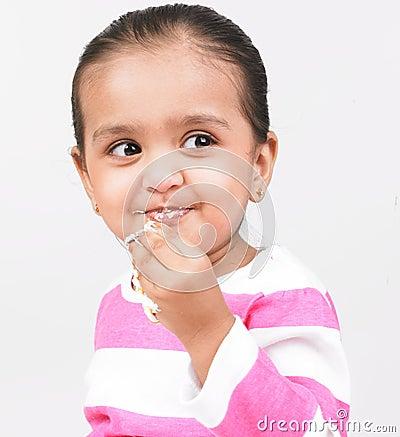 Girl enjoying cake