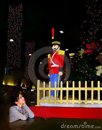 girl enjoying christmas toy soldier Editorial Photography