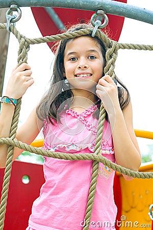 Girl enjoying climbing rope activity
