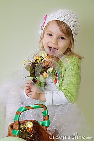 Girl enjoying spring flower blossom
