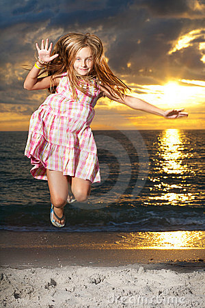 Girl enjoys summer day at the beach.