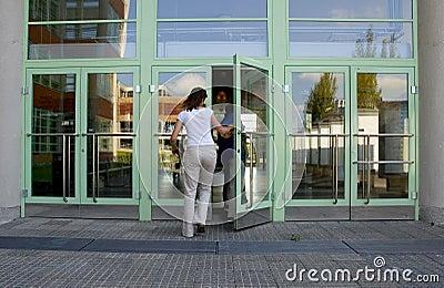 Girl entering building