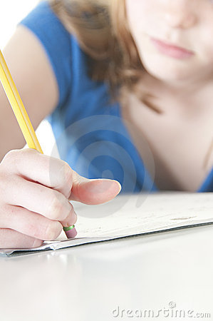 Girl erasing mistake with homework