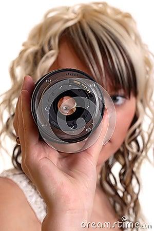 Girl examine lense
