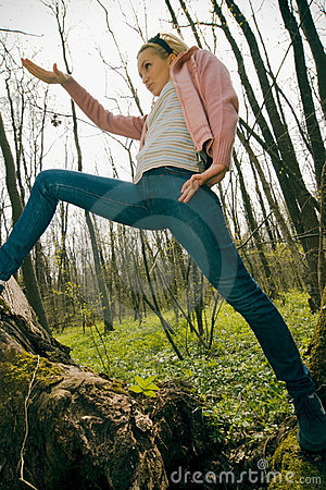 Girl exercising in the forest