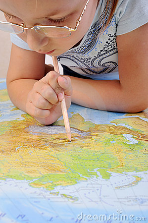 Girl exploring the map of Eurasia