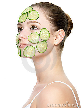 Girl with facial mask of cucumber