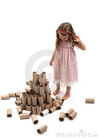 Girl and fallen paper rolls tower