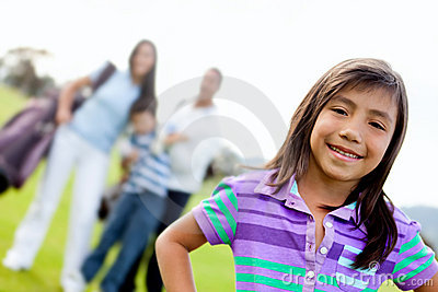 Girl and family playing golf