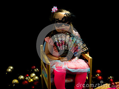 Girl with fan and mask in dress Stock Photo