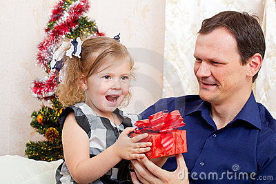 Girl with  father with Christmas gifts