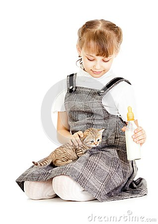 Girl feeding British kitten