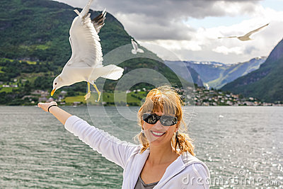 Woman enjoy seagull