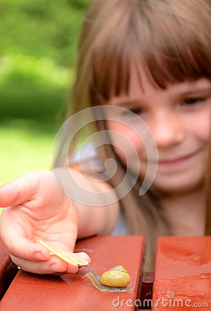 Girl feeding snail