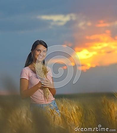 Girl feeling free in a beautiful wheat field Stock Photo
