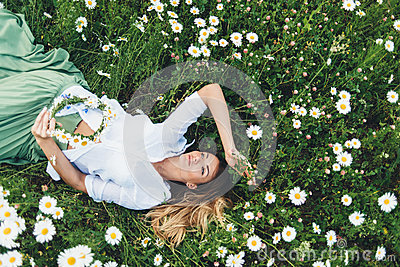 A girl in a field of chamomiles