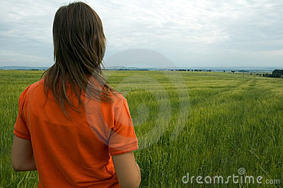 Girl in field overlooking valley