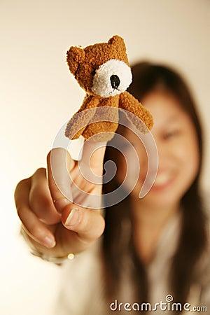 Girl with finger puppet bear