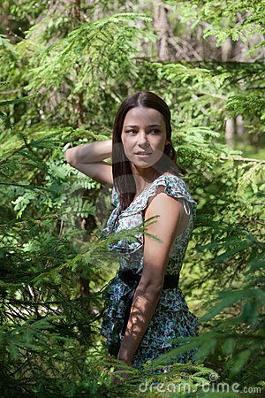 Girl in fir-tree wood