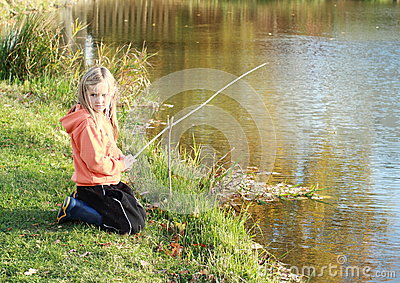 Girl fishing on pond